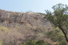 Geological Rock Layers in Mountain. The Gwalior System of The ancient lava rocks are comparatively exposed over a large area north-west of the eastern fault and Stock Photo