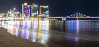 Gwangalli Beach in the nighttime with skyscrapers and city quay. Busan city, South Korea Stock Image
