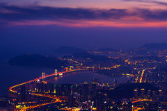 GwangAn Bridge and Haeundae at sunset in Busan. Royalty Free Stock Image
