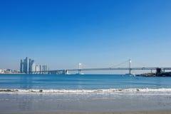 Gwangan bridge and speed boat in Busan. royalty free stock photography