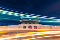 Gwanghwamun gate of Gyeongbokgung Palace in Seoul, South Korea with taillights and headlights of cars in front of it Stock Images