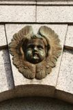 Cherub architectural detail on a Scottish building. royalty free stock photo