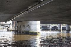 The The river Clyde flowing under a bridge in Glasgow city centre stock photography