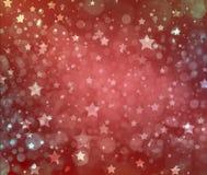 Gwiazdowy tło, błyskotliwy błyszczący srebro gra główna rolę na czerwonym materiale Obraz Stock