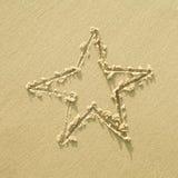 Gwiazdowy znak na piasku Zdjęcia Royalty Free