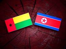 Gwinei Bissau flaga z koreańczyk z korei północnej flaga na drzewnym fiszorku Fotografia Stock