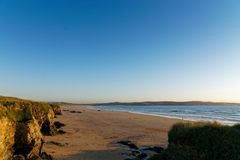 Gwithian Beach at Dusk. The beach at Gwithian at dusk royalty free stock photos