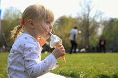 Eating icecream on a summers day. stock images
