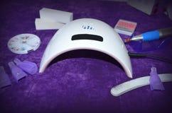 Gwoździa gel salon ULTRAFIOLETOWA lampa z zegarem Zdjęcie Royalty Free