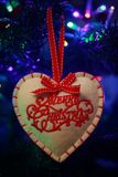 Close up of a Christmas decoration,. Close up of a red and white heart shaped Christmas decoration, with the words merry Christmas written on it and christmas royalty free stock photo