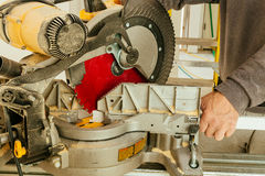 Gwood and sawing machine construction ideas concept. Wood and sawing machine construction ideas concept Circular Saw. Cutting a wooden plank Royalty Free Stock Photography