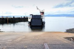 A ferry from the Islands reaches a mainland port. stock photos