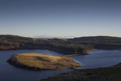 Sunrise on the hills and reservoir stock image