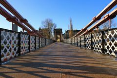 A old victorian foot bridge over the river Clyde stock photos