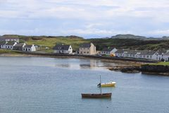 The Scottish town of Port Ellen on the island of Islay. A view of Port Ellen village on the Isle of Islay on west coast of Scotland stock images