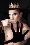 Gy with crown closed his mouth your fingers. Stock Photo