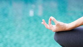 Gyan mudra hand yoga calm peace blue water background. Texture royalty free stock photo