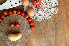 Gyckel i köket Arkivfoto