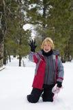 gyckel kastar snöboll Arkivfoto