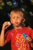 Gyckel med bubbelgum Arkivbilder