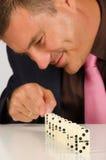 Gyckel med dominobrickastenar Royaltyfri Bild