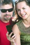 gyckel som har mobil royaltyfria bilder