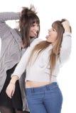 gyckel som har två kvinnor Arkivfoto