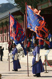 Gyeongbok Palace Seoul. Royal Changing of the Guard ceremony at Gyeongbok Palace Seoul, with two guardsmen holding banners and swords at the entrance to the Royalty Free Stock Image