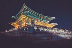 Gyeongbokgung main palace at night with writing in chinese meaning -. Gyeongbokgung palace at night with writing in chinese meaning - `diligence helps governance Royalty Free Stock Photos