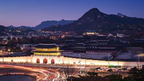 Gyeongbokgung Palace and Cars passing in front of Gwanghuamun gate in downtown Seoul, South Korea. Name of the Palace `Gyeongbokgu