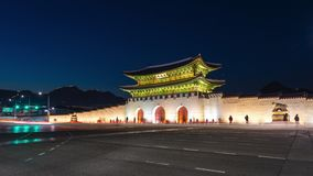 Gyeongbokgung Palace, Cars passing in front of Gwanghuamun gate at Night in Downtown Seoul, South Korea. Name of the Palace `Gyeon