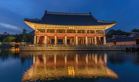 Gyeongbokgung Palace At Night. In South Korea, with the name of the palace 'Gyeongbokgung' on a sign Royalty Free Stock Photo