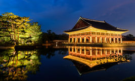 Gyeongbokgung Palace At Night. In South Korea, with the name of the palace 'Gyeongbokgung' on a sign Stock Photography