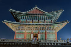 Gyeongbokgung Palace At Night. In South Korea, with the name of the palace 'Gyeongbokgung' on a sign Stock Images