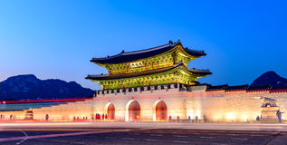 Gyeongbokgung Palace At Night In South Korea. With the name of the palace `Gyeongbokgung` on a sign Stock Image