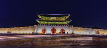 Gyeongbokgung Palace At Night In South Korea. With the name of the palace `Gyeongbokgung` on a sign Royalty Free Stock Images