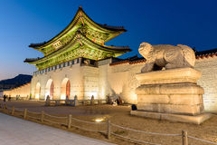 Gyeongbokgung Palace At Night In South Korea. With the name of the palace `Gyeongbokgung` on a sign Royalty Free Stock Photo