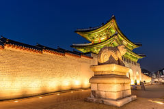 Gyeongbokgung Palace At Night In South Korea. With the name of the palace `Gyeongbokgung` on a sign Royalty Free Stock Image