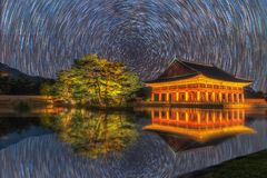 Gyeongbokgung Palace At Night In South Korea, with the name of the palace `Gyeongbokgung` on a sign. Gyeongbokgung Palace At Night In South Korea, with the name Stock Images