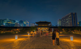 Gyeongbokgung Palace At Night In South Korea. With the name of the palace 'Gyeongbokgung' on a sign Royalty Free Stock Images