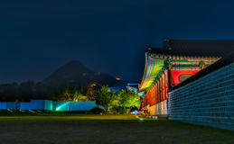 Gyeongbokgung Palace At Night In South Korea. With the name of the palace 'Gyeongbokgung' on a sign Stock Photos