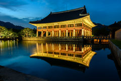 Gyeongbokgung Palace At Night In South Korea. With the name of the palace 'Gyeongbokgung' on a sign Royalty Free Stock Image