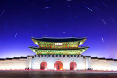 Gyeongbokgung Palace with Star trails at night in Korea. Royalty Free Stock Image