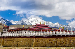 Gyergo monastery and Mount Yala by tagong grassland in Sichuan province stock image