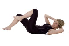 Gym. Beautiful young woman stretching on white background Stock Photo