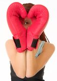 Gym #27. A woman in gym clothes, wearing red boxing gloves stock photography