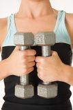 Gym #41. A woman in gym clothes, training with weights stock photography