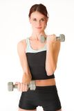 Gym #5. A woman in gym clothes, holding weights royalty free stock images