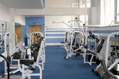 Gym. Fitness gym hall interior blue background Royalty Free Stock Photos