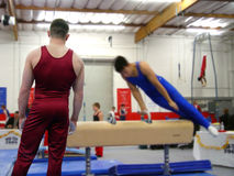 At the gym. Boy watching his friend practicing on pommel Stock Images